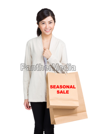 young, woman, holding, shopping, bag, and - 20551225