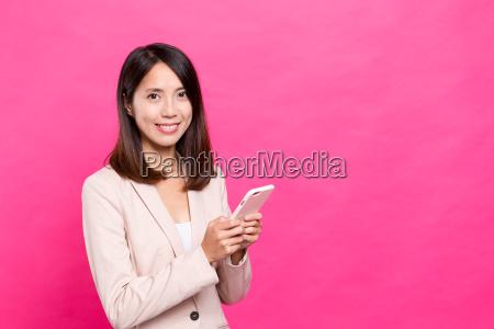 asian businesswoman using cellphone