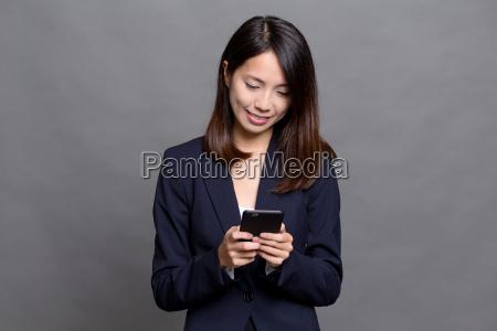 asian, businesswoman, using, cellphone - 20552933
