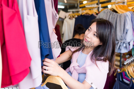 woman picking up dress in weekend