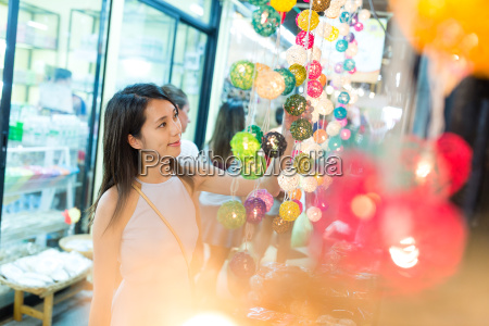 woman shopping at decoration lantern in