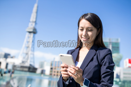 businesswoman, using, mobile, phone - 20553059