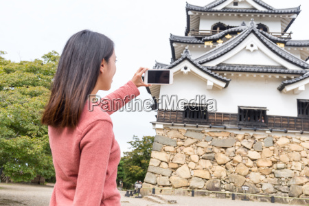 woman, taking, photo, on, hikone, castle - 20553005