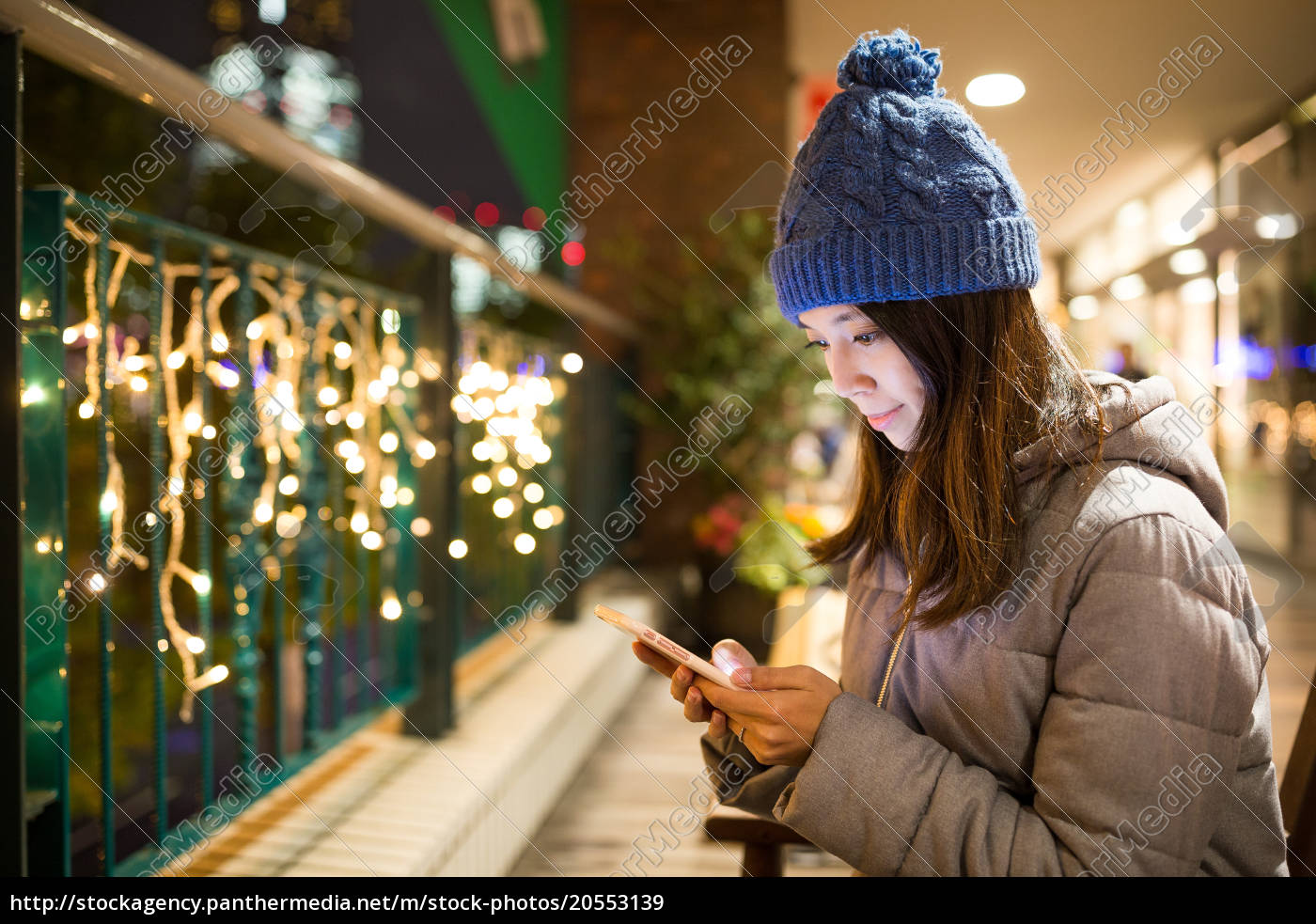 young, woman, sending, sms, on, mobile - 20553139