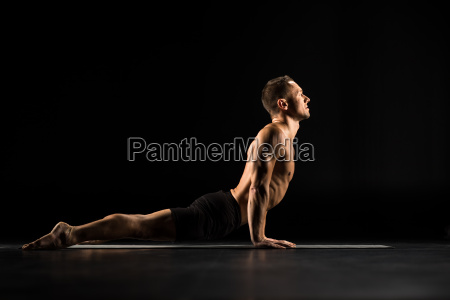 man, lying, in, yoga, position - 20556781