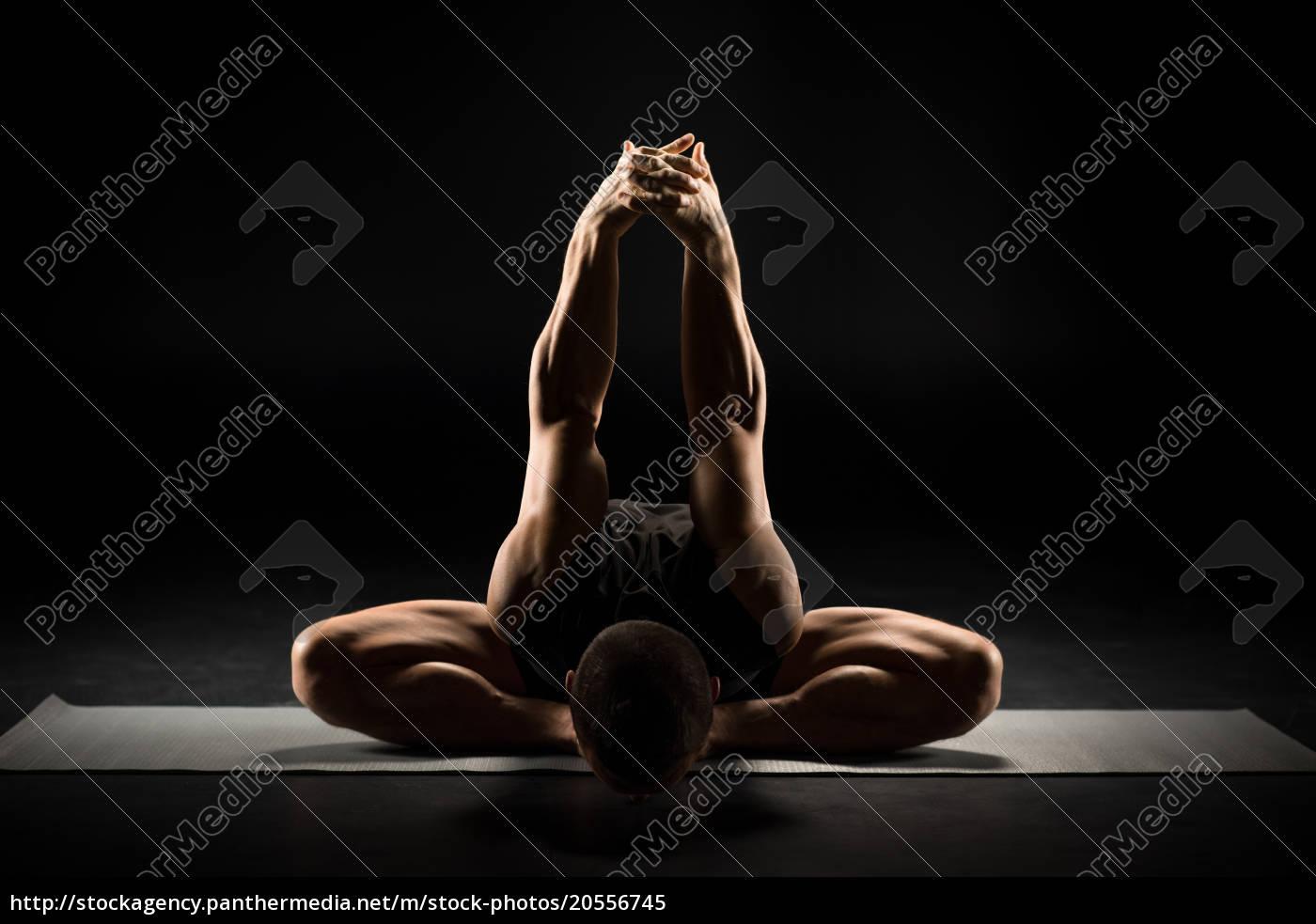 man, sitting, in, yoga, position - 20556745