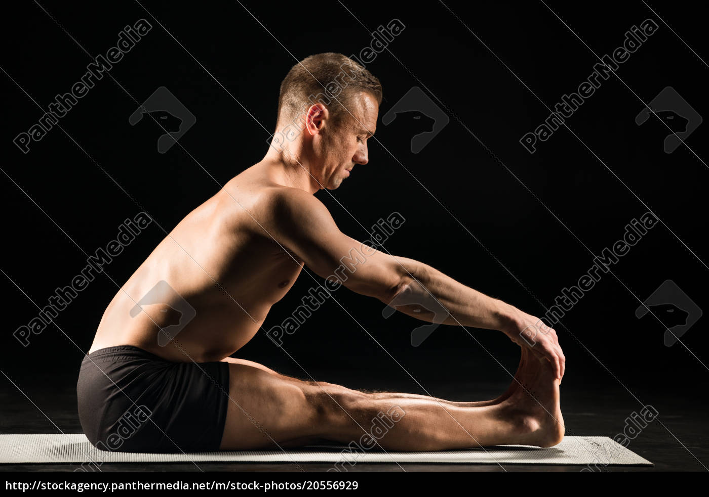man, sitting, in, yoga, position - 20556929