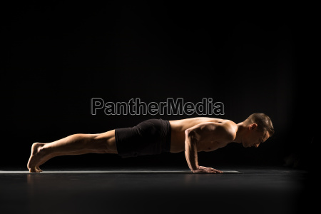 man, standing, in, yoga, position - 20556775