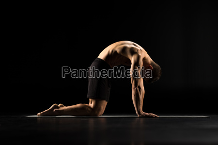 man, standing, in, yoga, position - 20556783