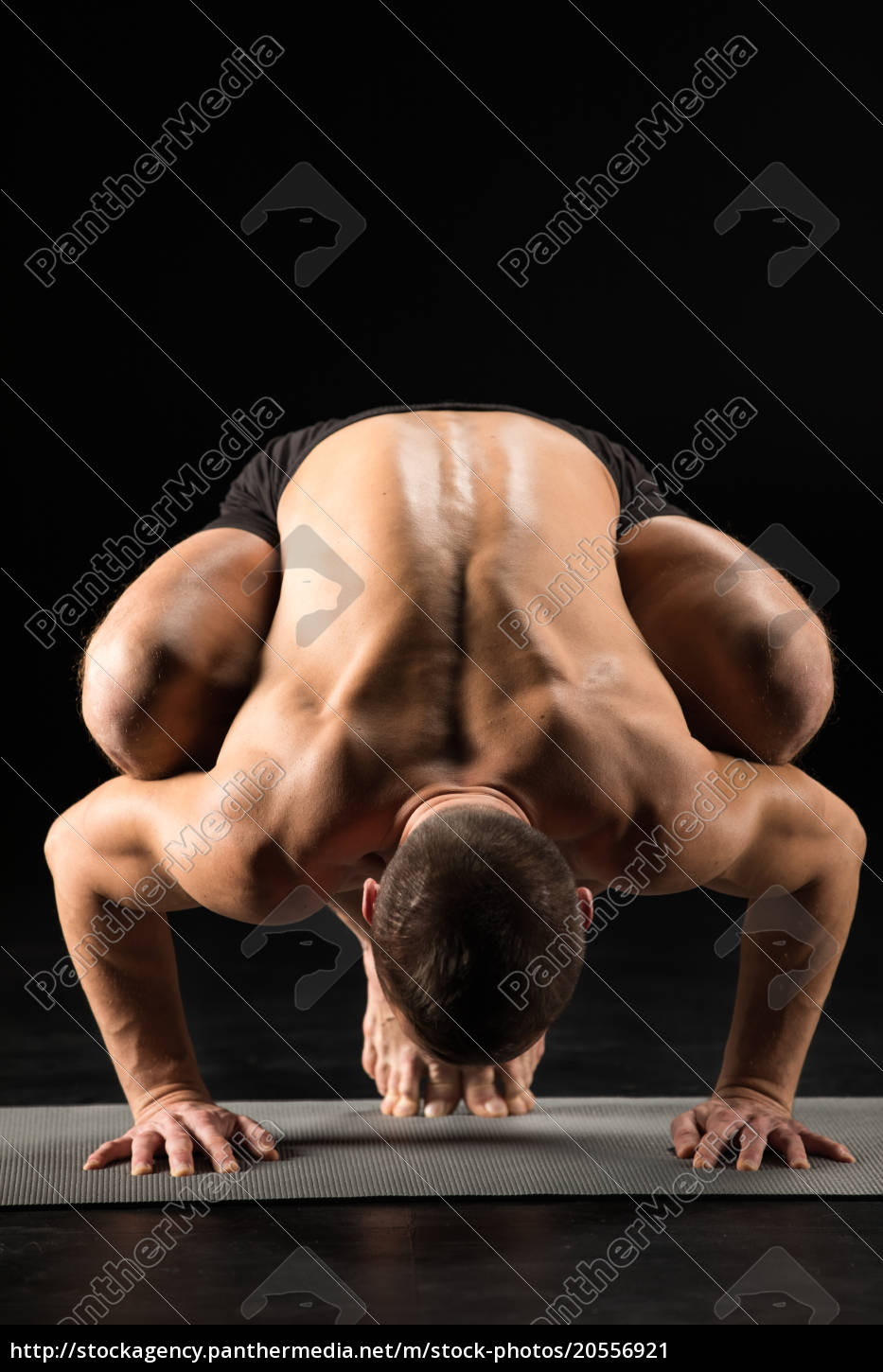 man, standing, in, yoga, position - 20556921
