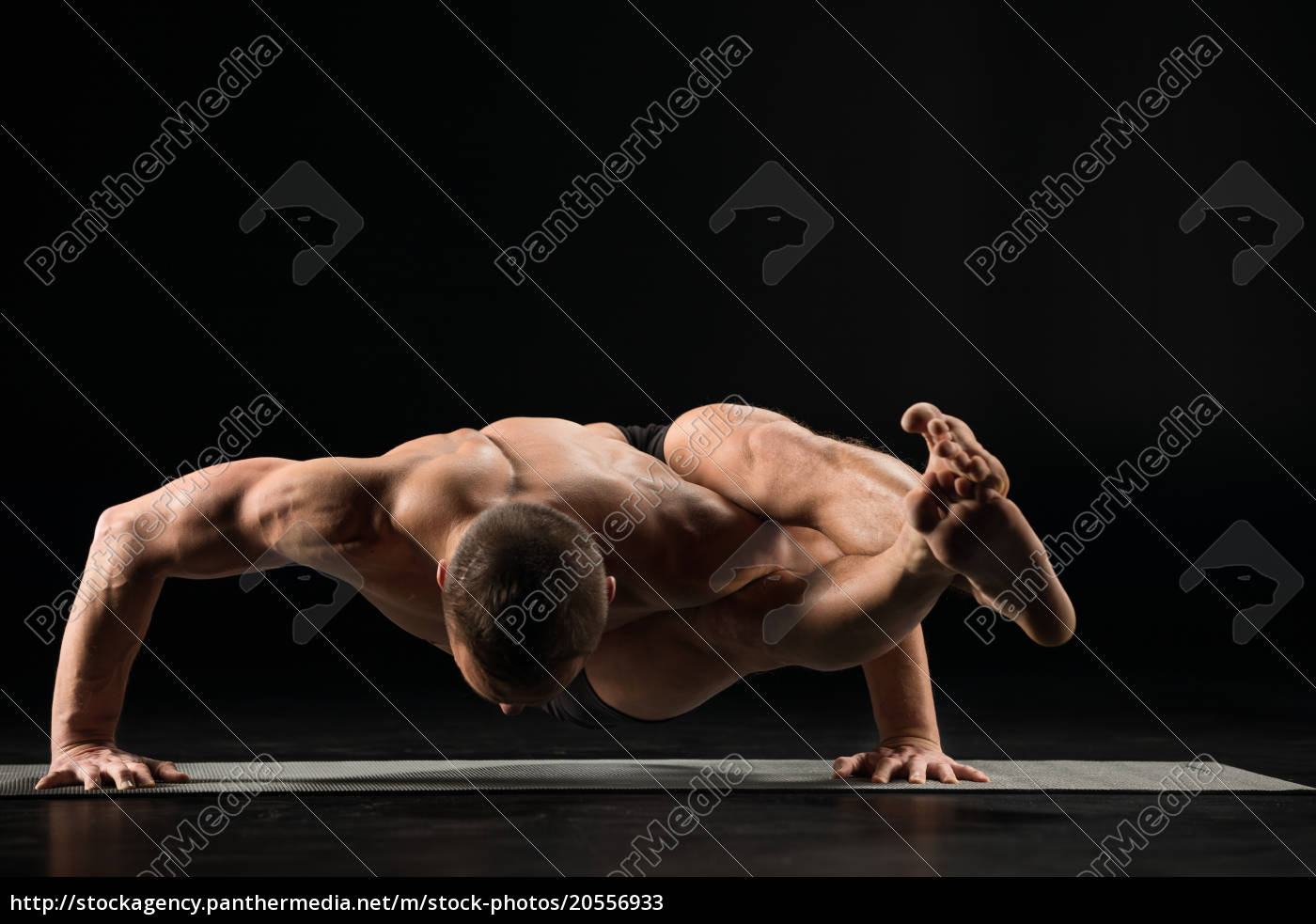 man, standing, in, yoga, position - 20556933