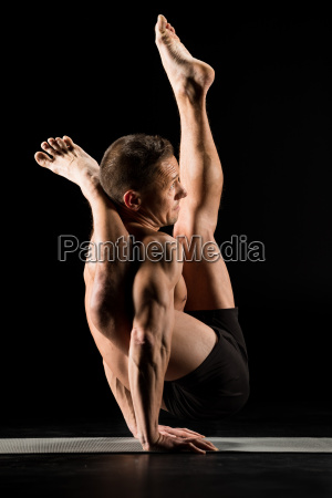 man, standing, in, yoga, position - 20556979