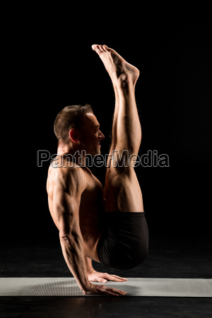 man, standing, in, yoga, position - 20556983
