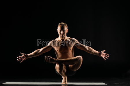 man, standing, in, yoga, position - 20556993