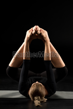 woman, lying, in, yoga, position - 20556743