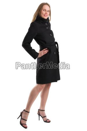 attractive blonde woman in black winter