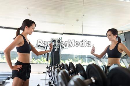 fitness woman taking selfie in gym