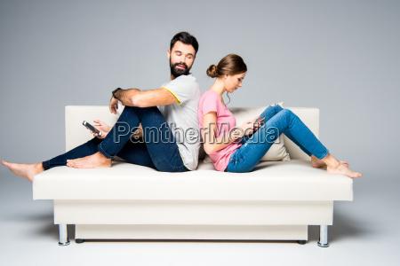 couple, using, smartphones - 20557729