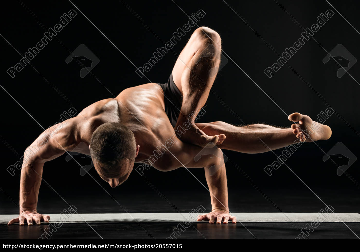 man, standing, in, yoga, position - 20557015
