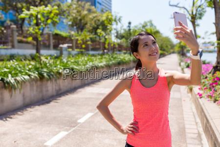 sport, woman, taking, selfie, by, mobile - 20557979