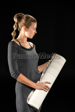 sportswoman, holding, yoga, mat - 20557007
