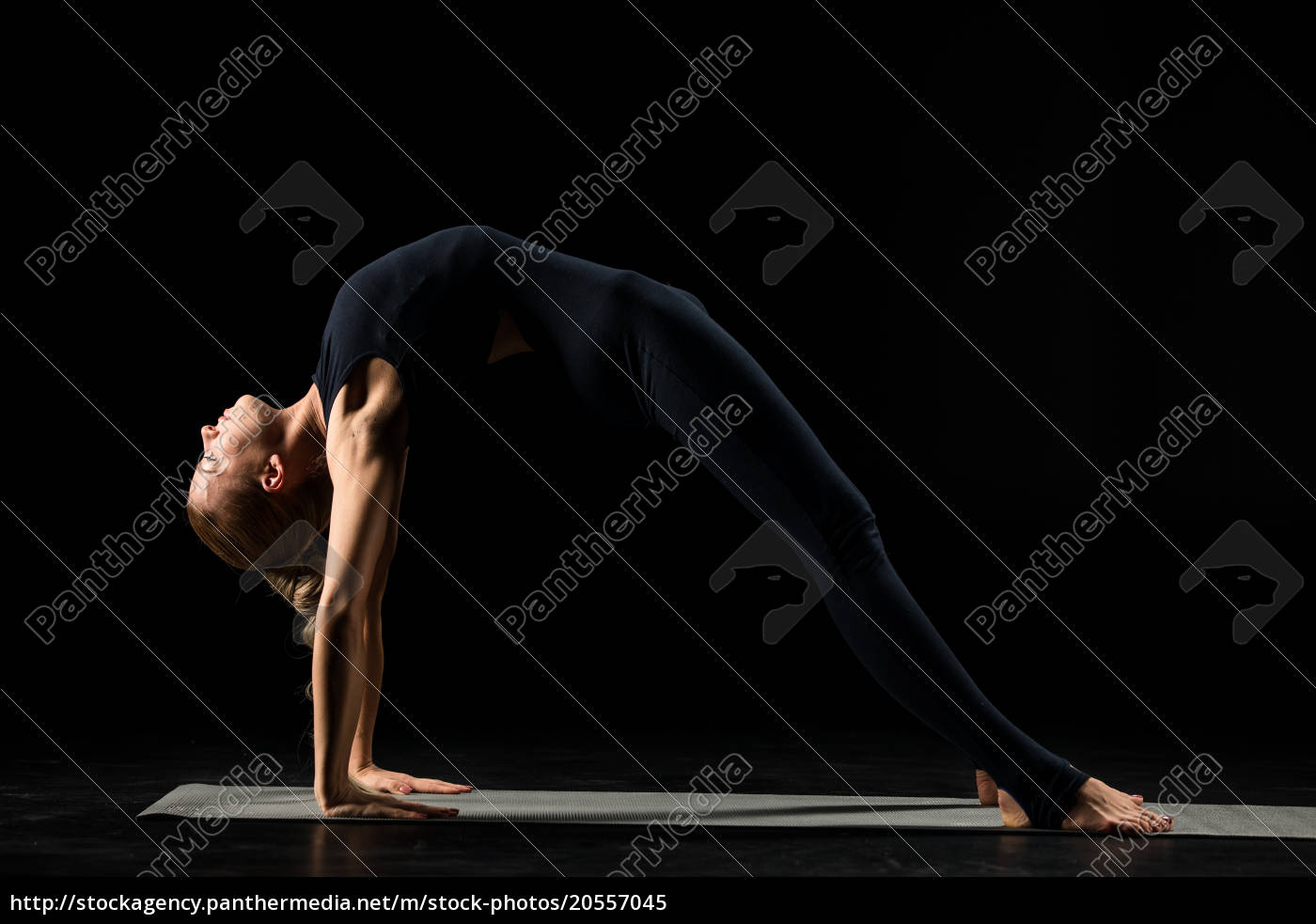 woman, standing, in, yoga, position - 20557045