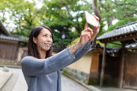 woman, taking, selfie, photo, with, mobile - 20557801