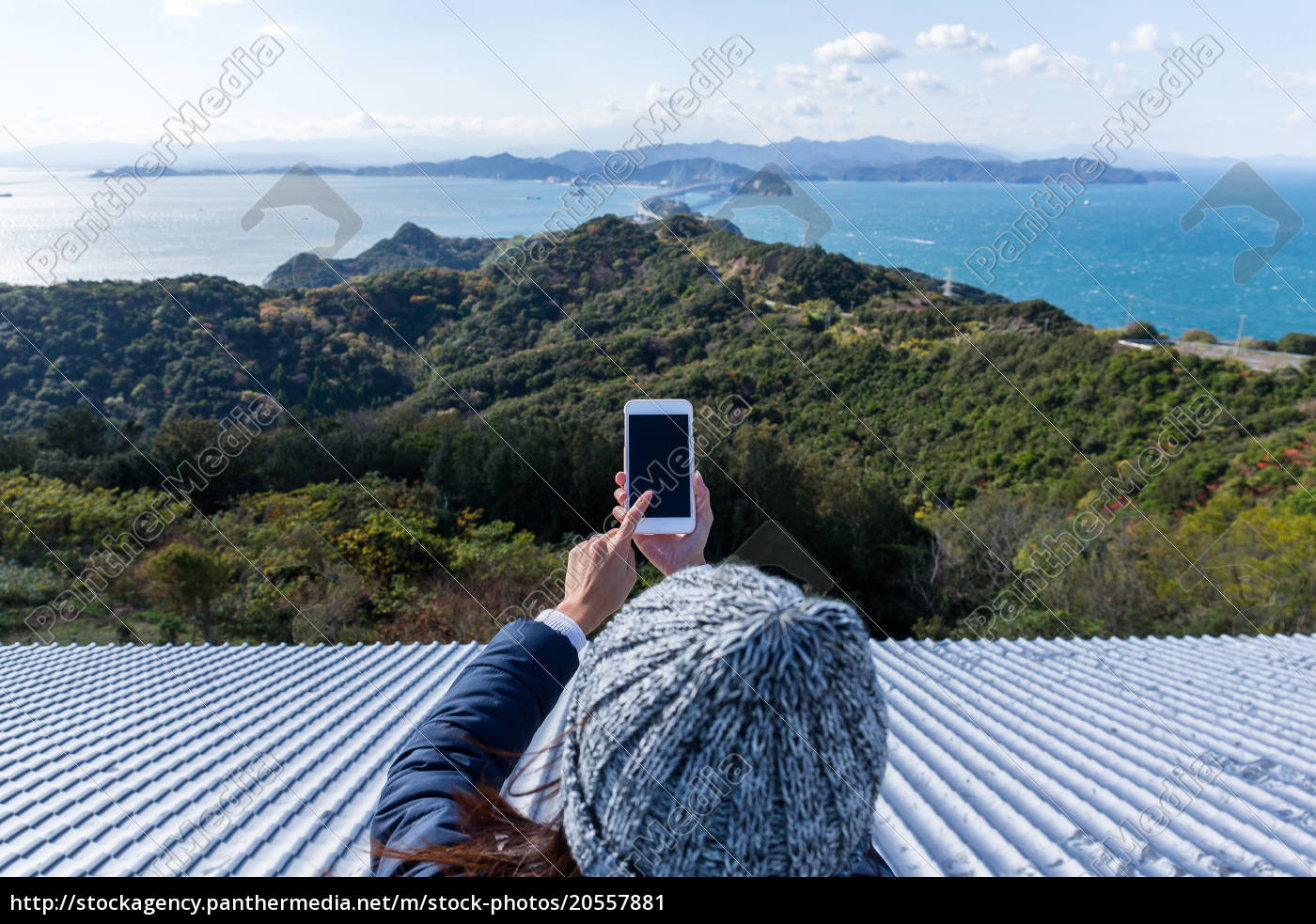 woman, using, cellphone, to, take, photo - 20557881