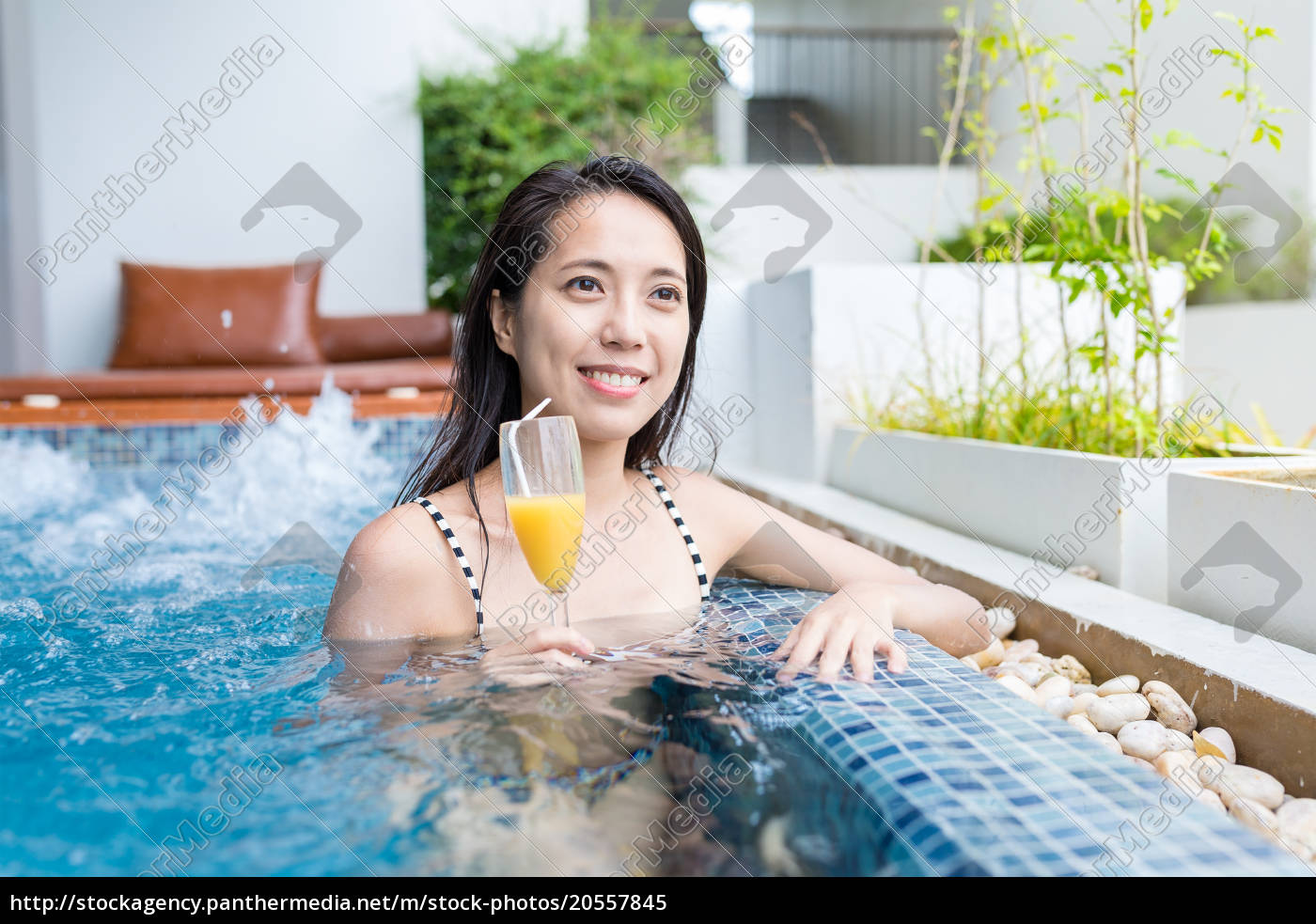 young, woman, enjoy, her, drink, in - 20557845