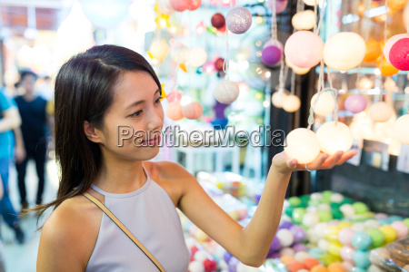 young woman shopping at weekend market