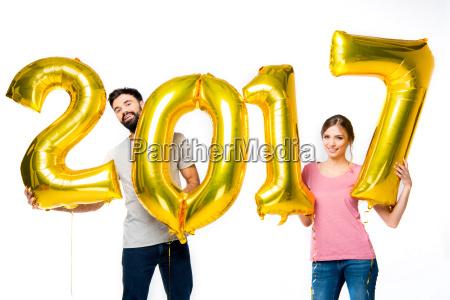 couple, holding, golden, balloons - 20558287