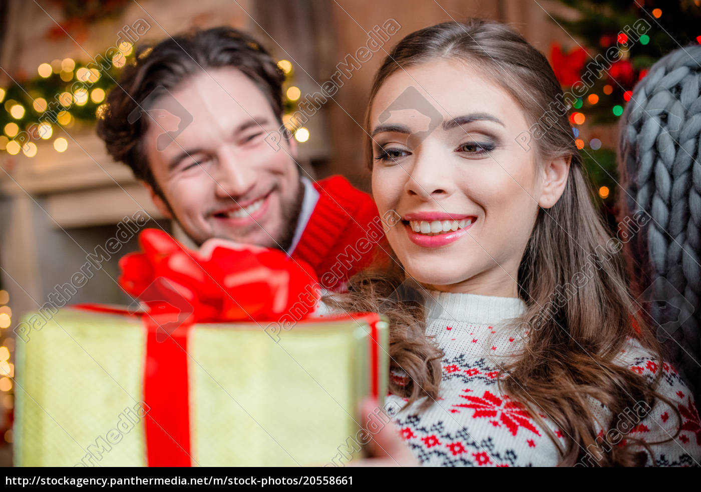 happy, couple, with, christmas, present - 20558661