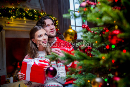 happy, couple, with, christmas, present - 20558701