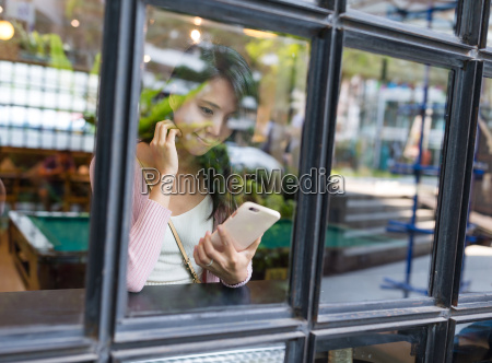 window, reflection, of, woman, use, of - 20558015