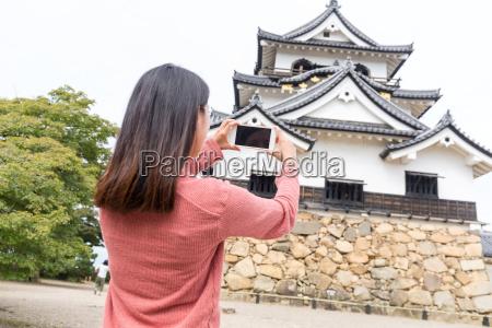 woman, taking, photo, on, hikone, castle - 20558917