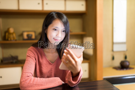 young, woman, using, mobile, phone, in - 20558923