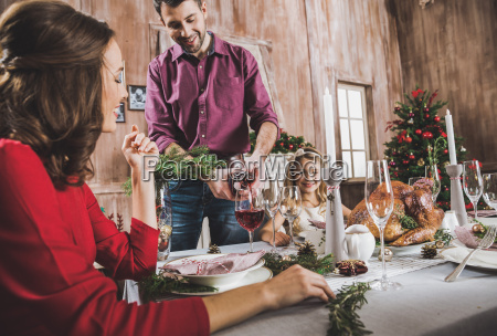 happy family at holiday table