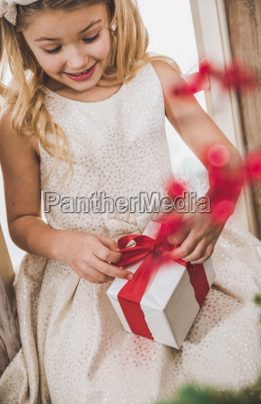 girl opening gift box