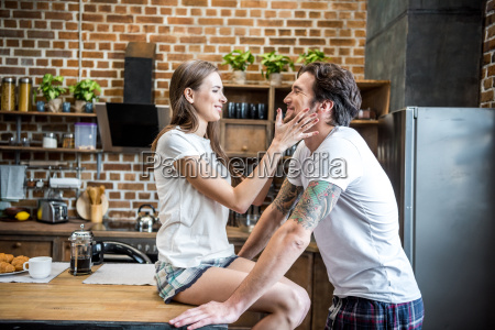 couple, having, fun, in, kitchen - 20559133