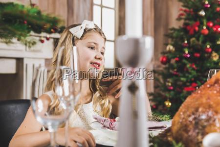 cute, girl, at, holiday, table - 20559233