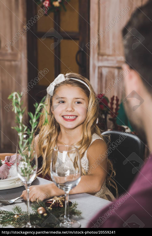 cute, girl, at, holiday, table - 20559241