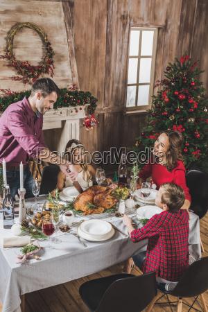 family, having, christmas, dinner - 20559369