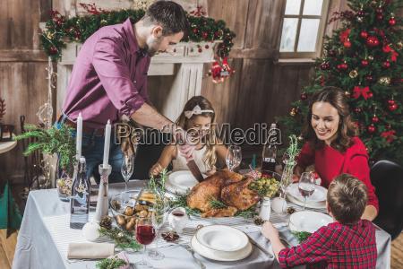 family, having, christmas, dinner - 20559371