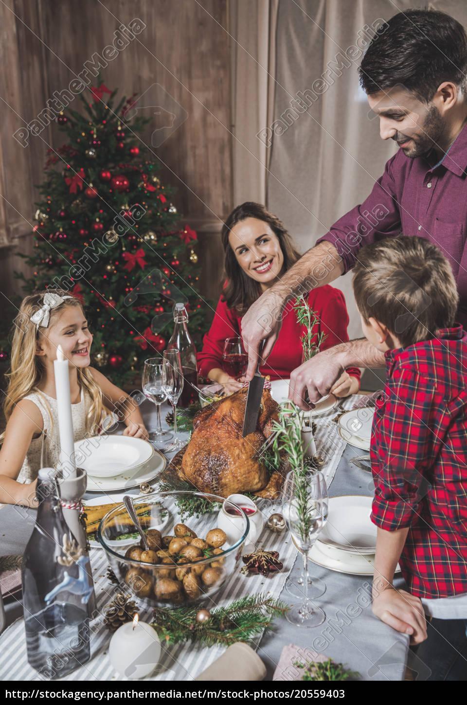 family, having, christmas, dinner - 20559403