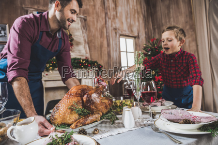 father, and, son, serving, festive, table - 20559355