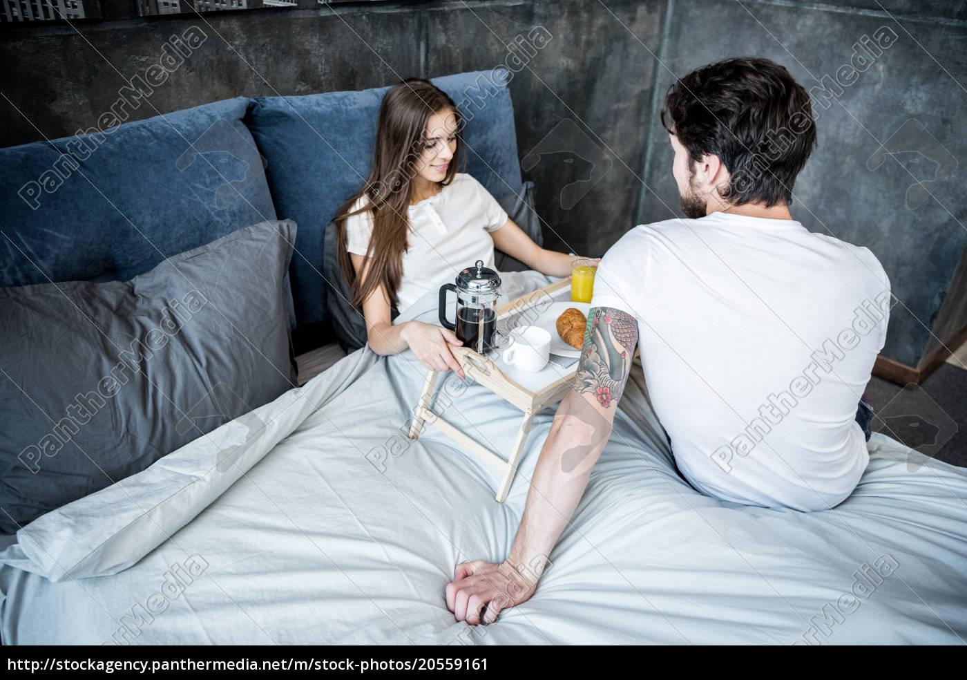 man, brings, breakfast, in, bed - 20559161