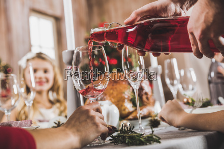man, pouring, wine, in, glass - 20559265