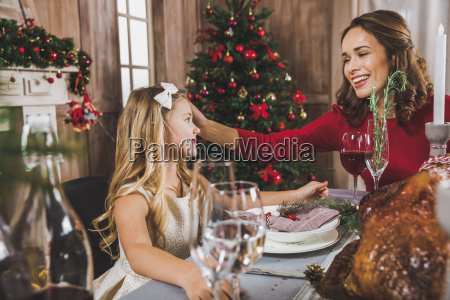 mother, and, daughter, at, holiday, table - 20559187