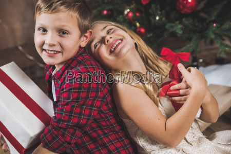 siblings, holding, gift, boxes - 20559325