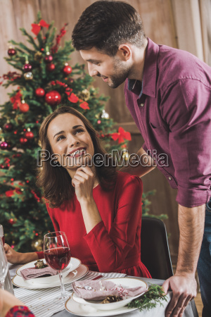 smiling, couple, at, holiday, table - 20559193